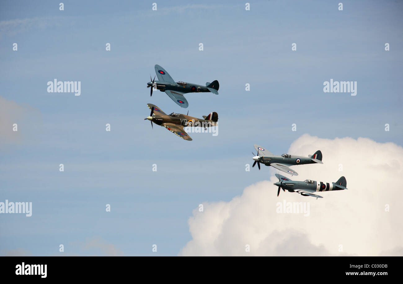 Three Spitfires and one Hurricane in formation - Stock Image