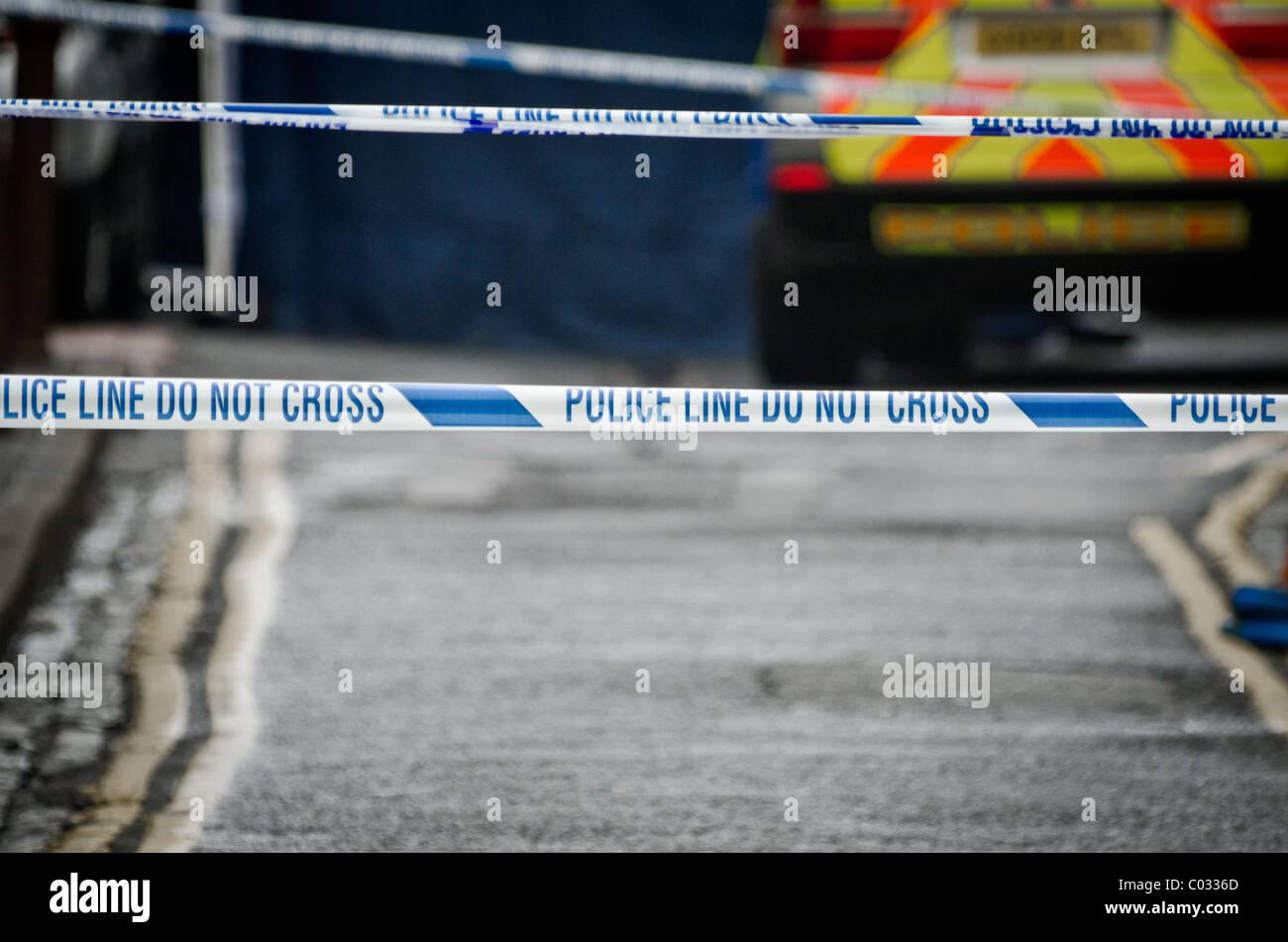 Police investigate the crime scene where police shot dead a suspect - Stock Image