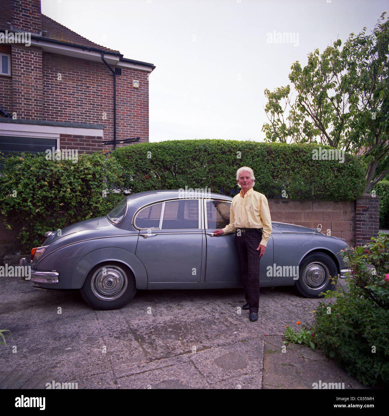 1960s Daimler 2.5L Classic saloon car and owner, Worthing, West Sussex, UK - Stock Image