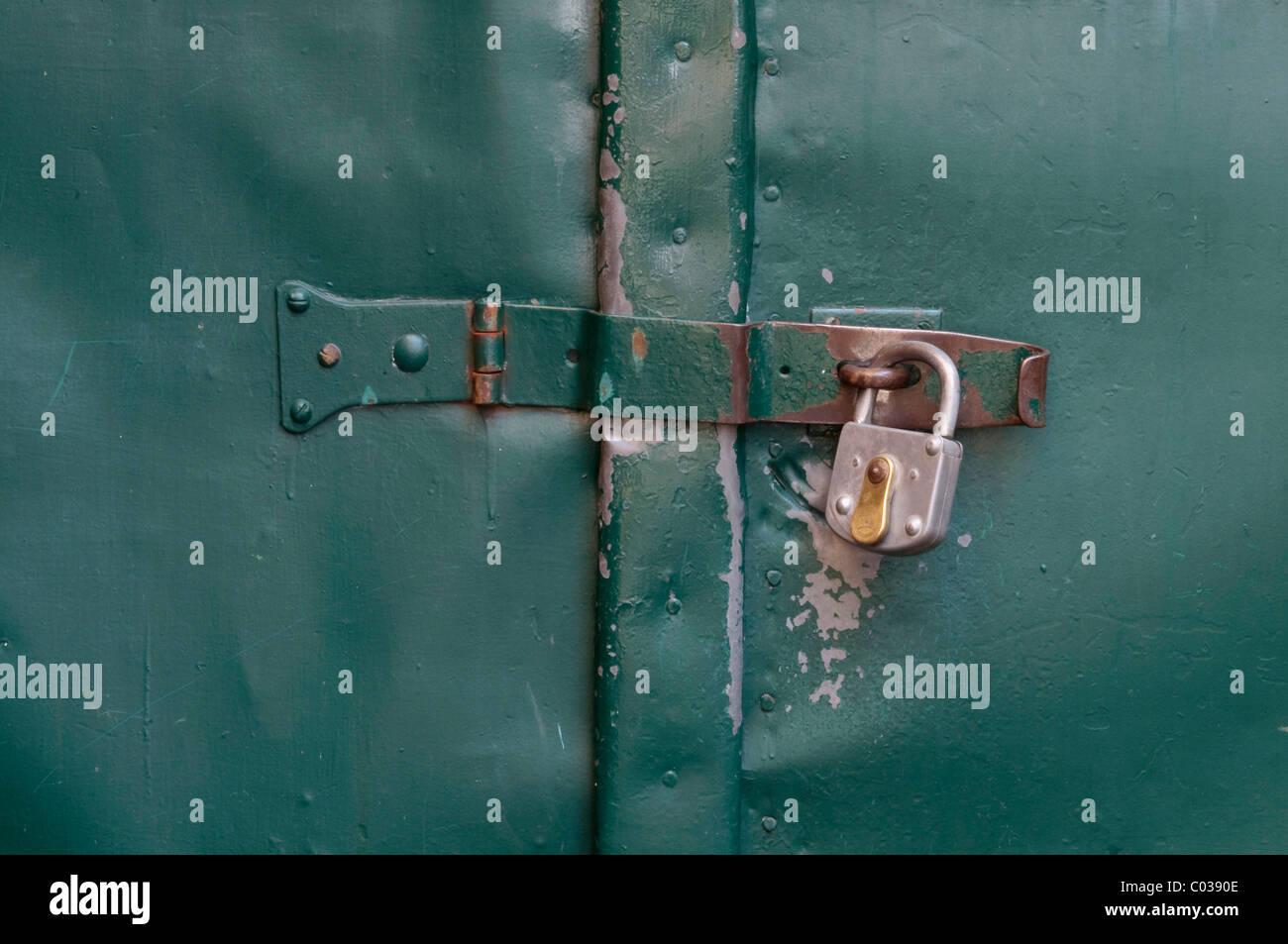 Padlocked gate latch - Stock Image