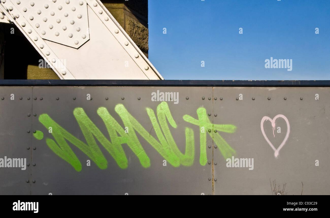 Graffiti on bridge over River Irwell, Manchester / Salford boundary, Manchester, UK - Stock Image