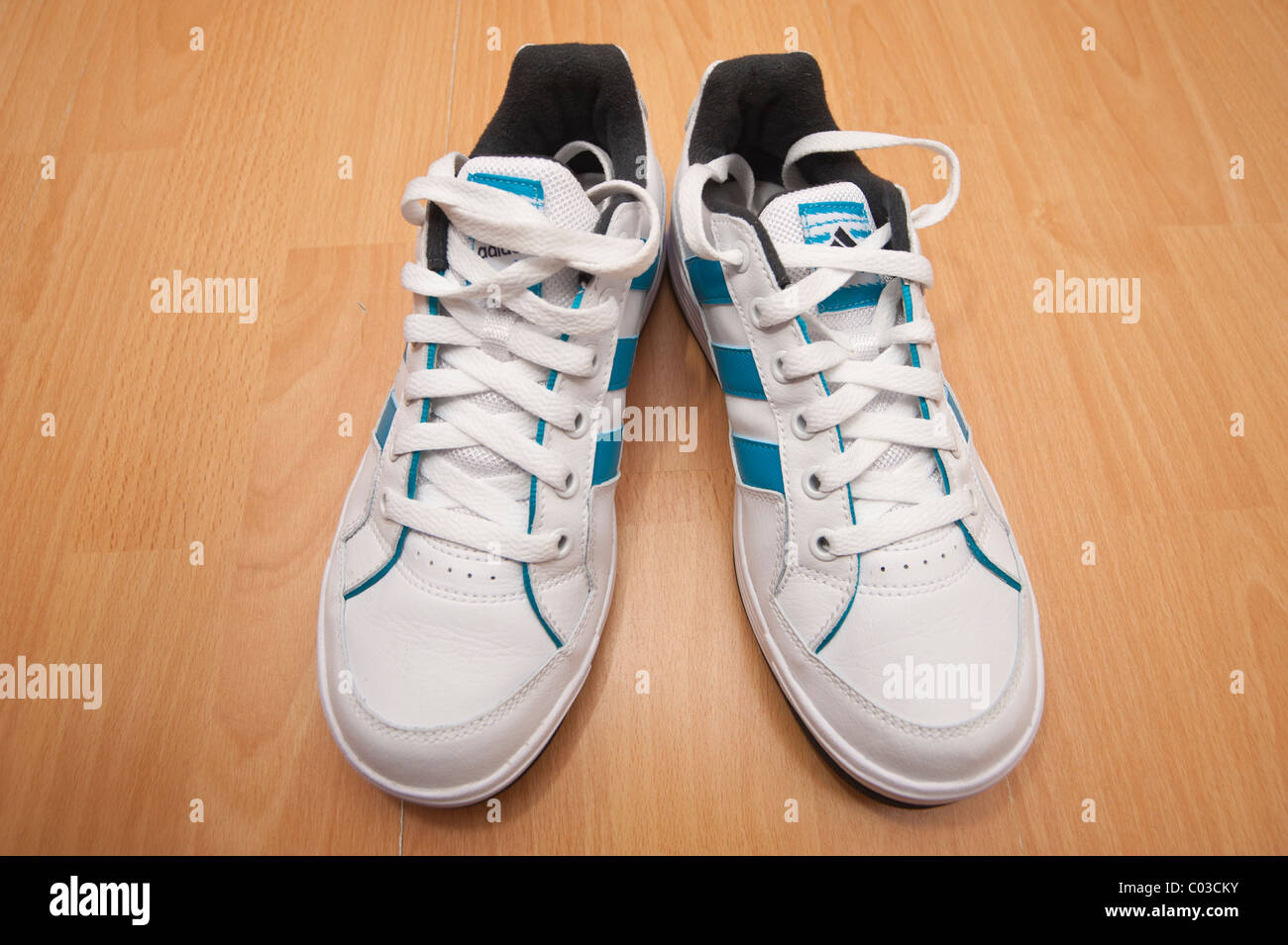 A picture of a brand new pair of adidas lace up training shoes ( trainers ) - Stock Image