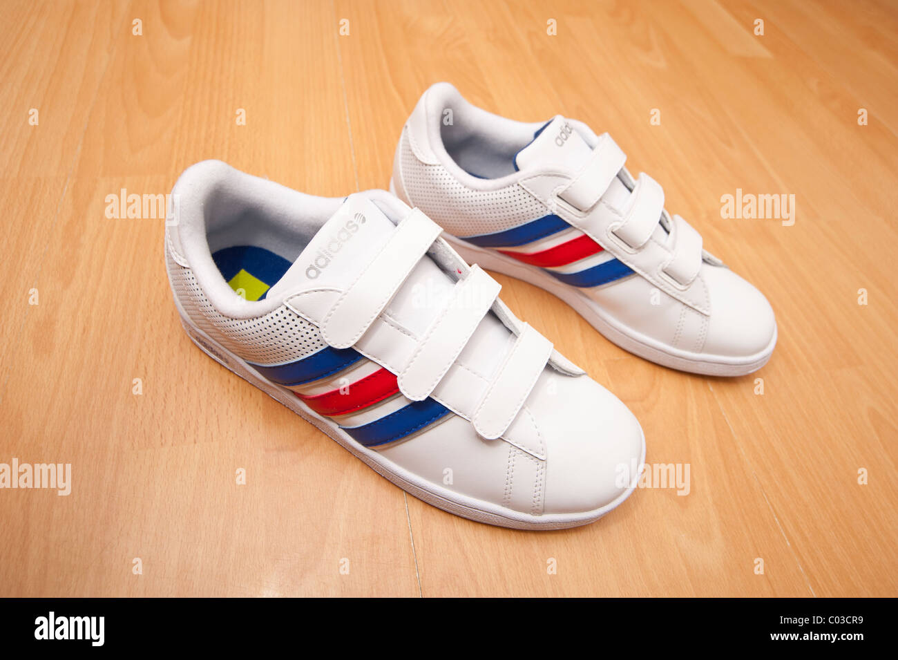 A picture of a brand new pair of adidas velcro fastening for kids training shoes ( trainers ) - Stock Image