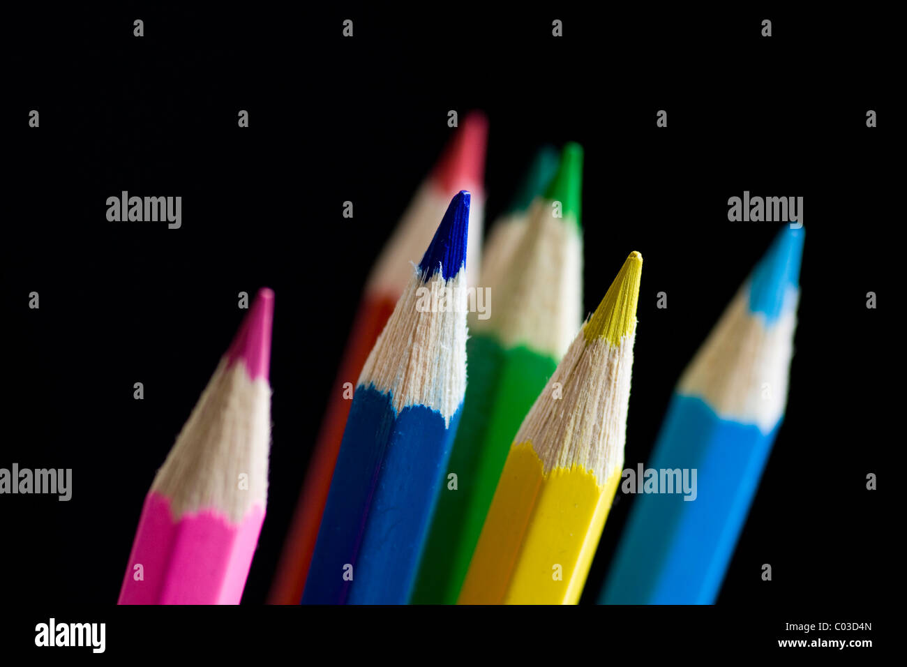 Color pencils on black background. Selective focus. - Stock Image