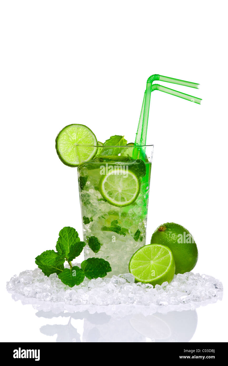 Photo of a Mojito cocktail with fresh lime and mint leaves isolated on a white background. - Stock Image