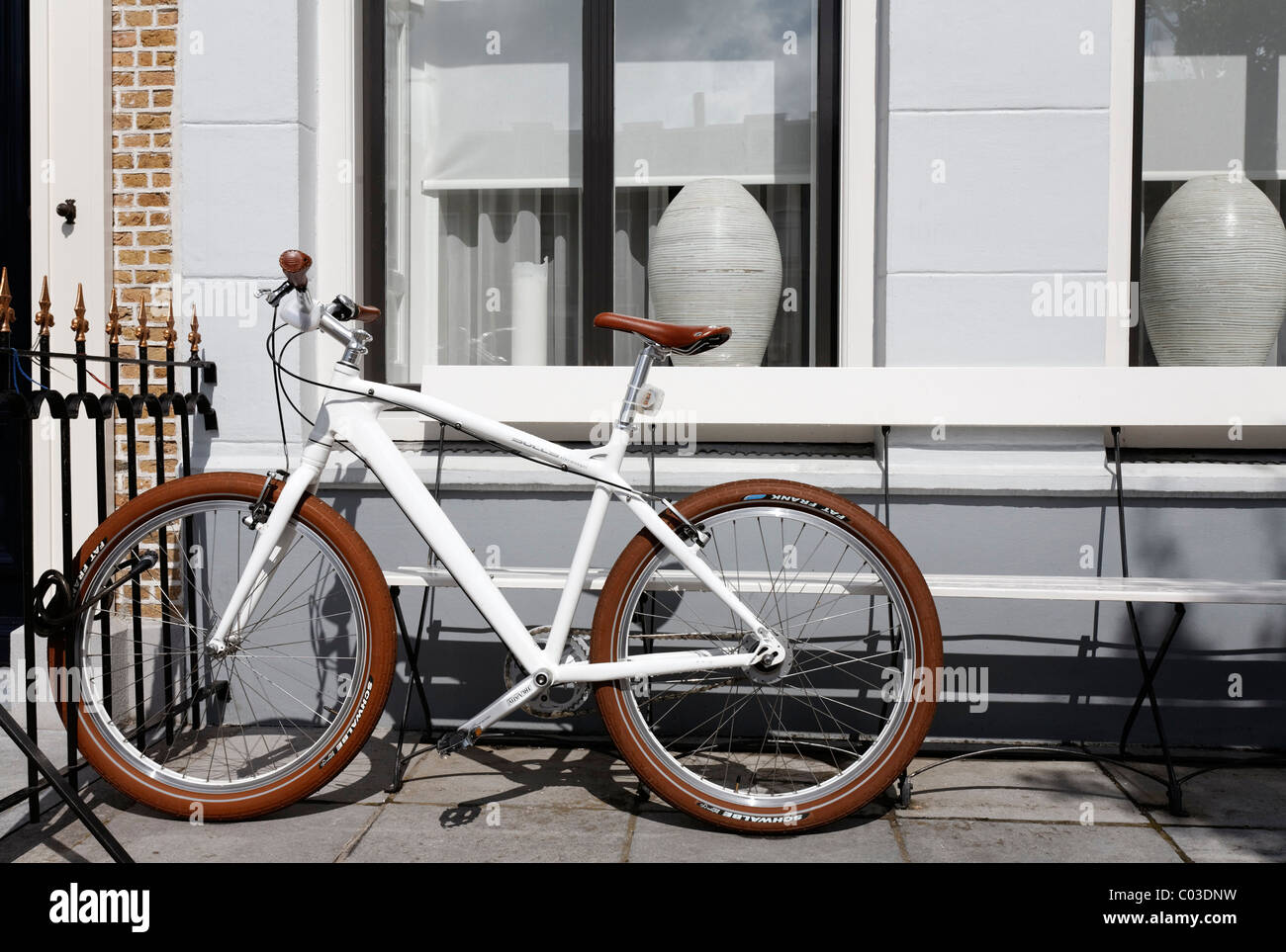 White designer bike, parked in the front yard of a house, Goes, Zeeland province, Netherlands, Benelux, Europe - Stock Image