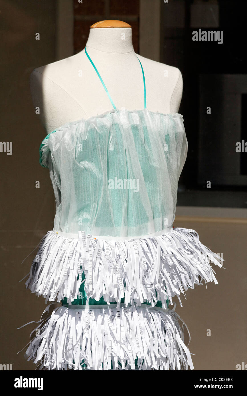 Fancy dress with a tiered skirt made of shredded paper in a shop window, clothing created by fashion students, Middelburg - Stock Image