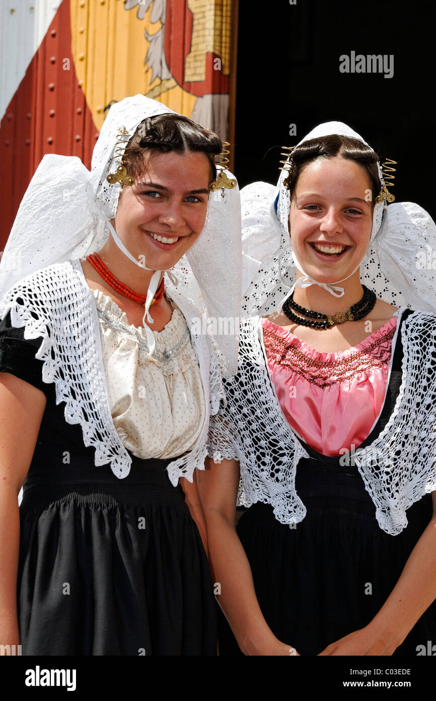 Two young girls wearing traditional costumes of the Zeeland province, Middelburg, Walcheren peninsula, Netherlands, Stock Photo