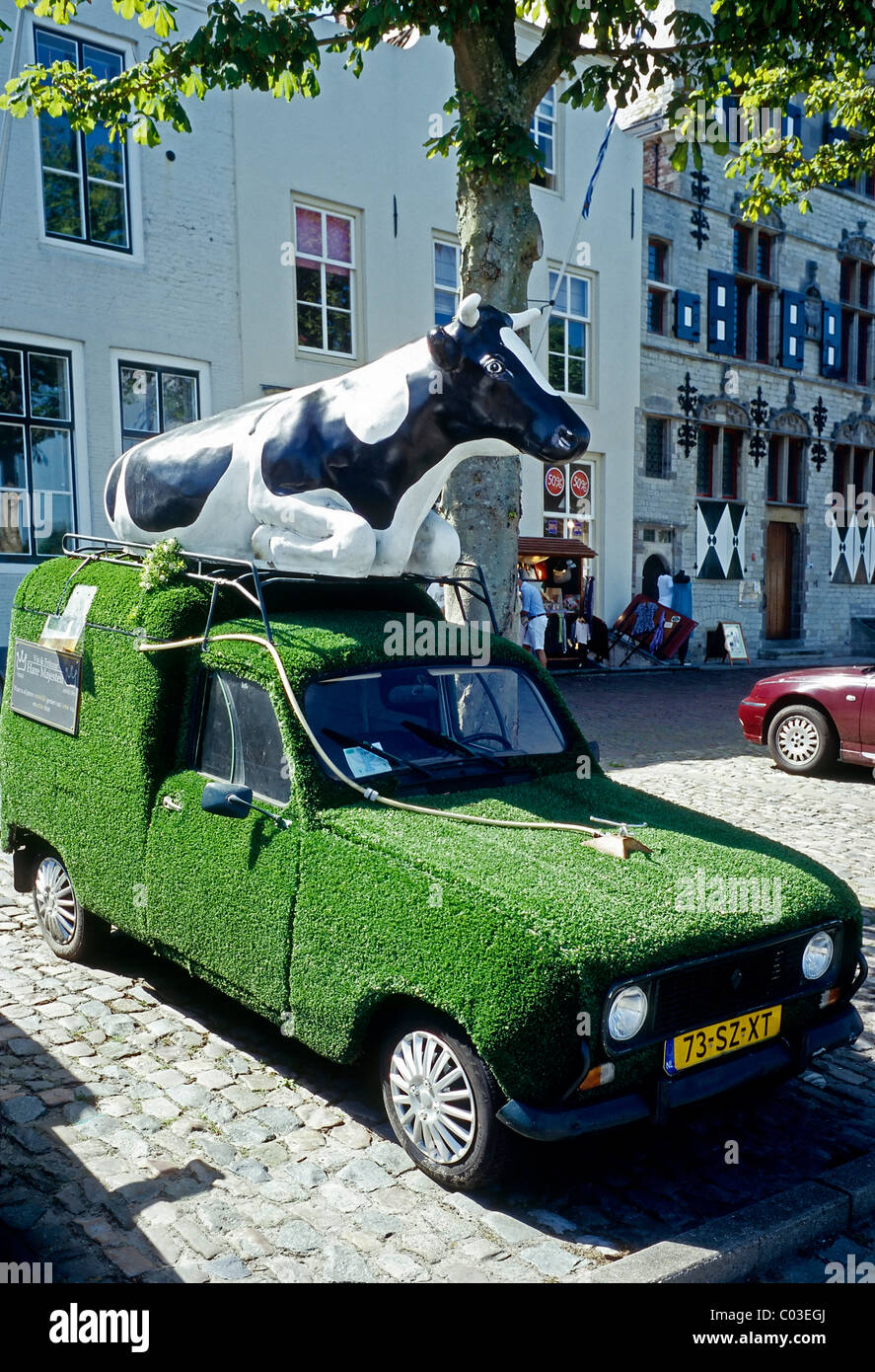 Inventive car with a cow on the roof, body covered with artificial turf, Veere, Walcheren, Zeeland, Netherlands, - Stock Image