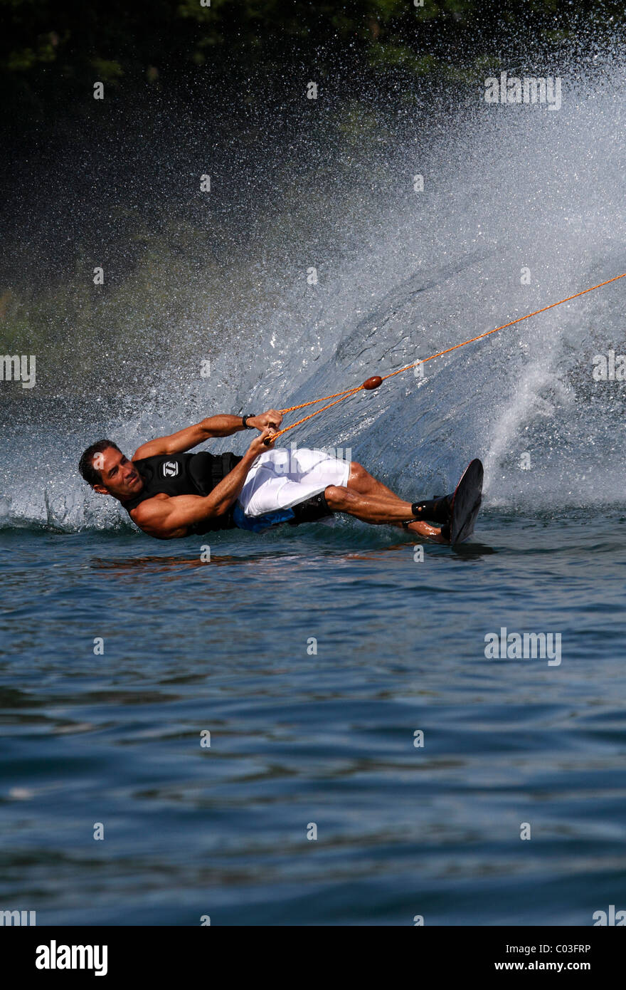 Surfer with wakeboard, Nordstrand lake near Erfurt, Thuringia, Germany, Europe - Stock Image