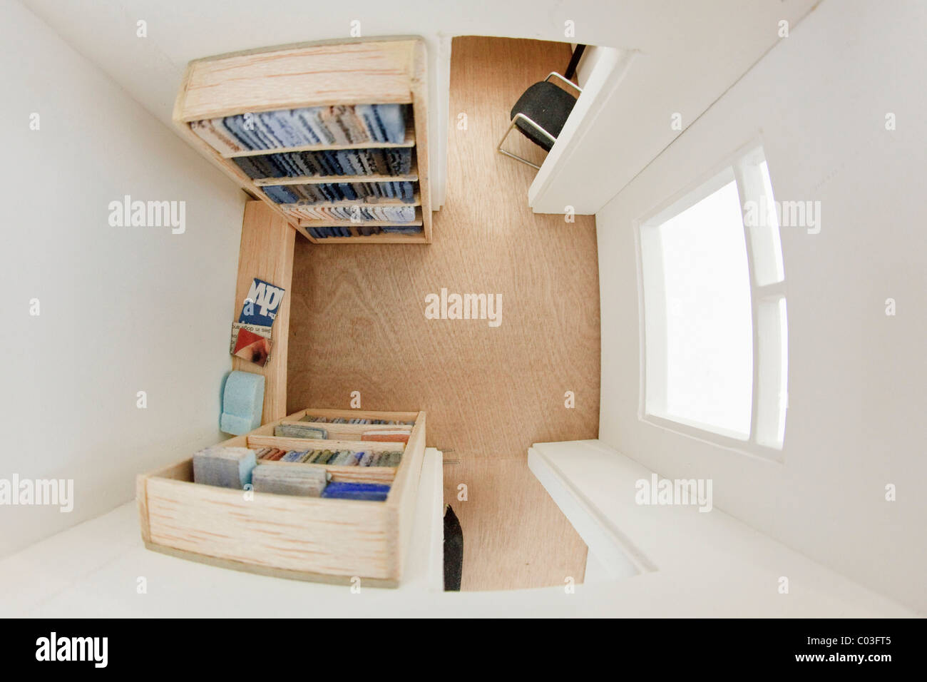 View into a room with book shelves in a doll's house - Stock Image