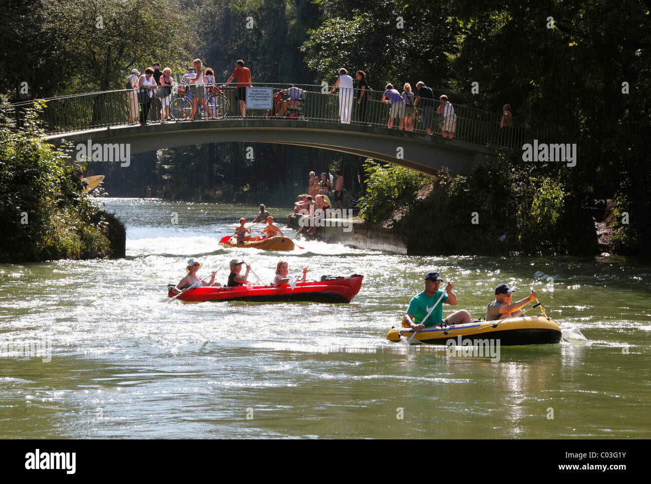 Inflatable boats on the Isar Flosskanal canal, Thalkirchen, Munich, Upper Bavaria, Bavaria, Germany, Europe - Stock Image