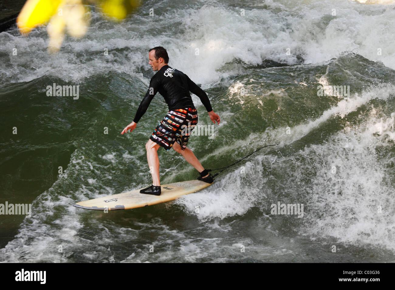 Surfer on a wave in the Eisbach stream, English Garden, Munich, Upper Bavaria, Bavaria, Germany, Europe Stock Photo
