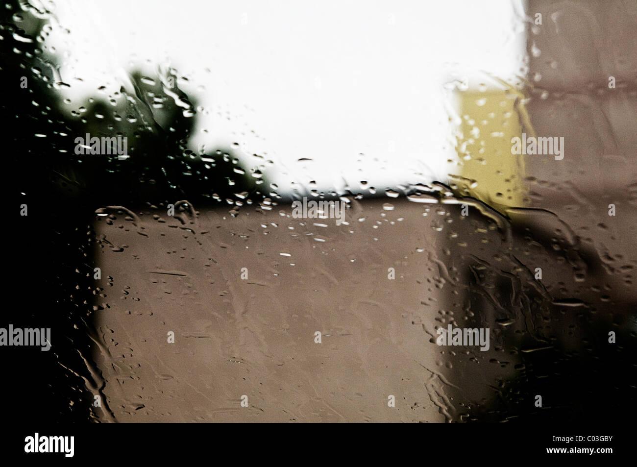 Looking through a rain-soaked window pane Stock Photo
