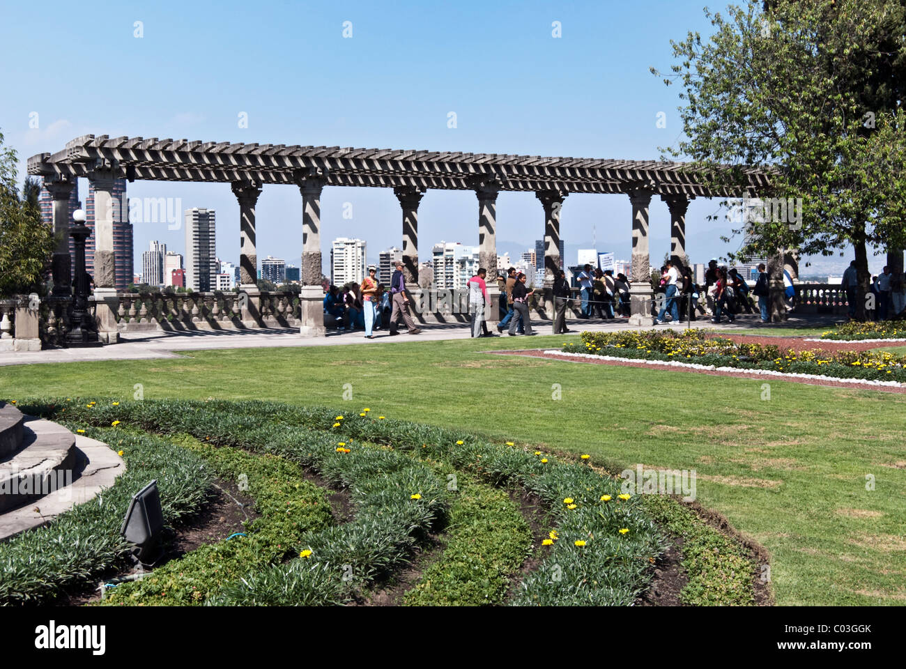 Chapultepec Castle garden green lawn parterre & magnificent view of modern Mexico City skyline from trellised - Stock Image