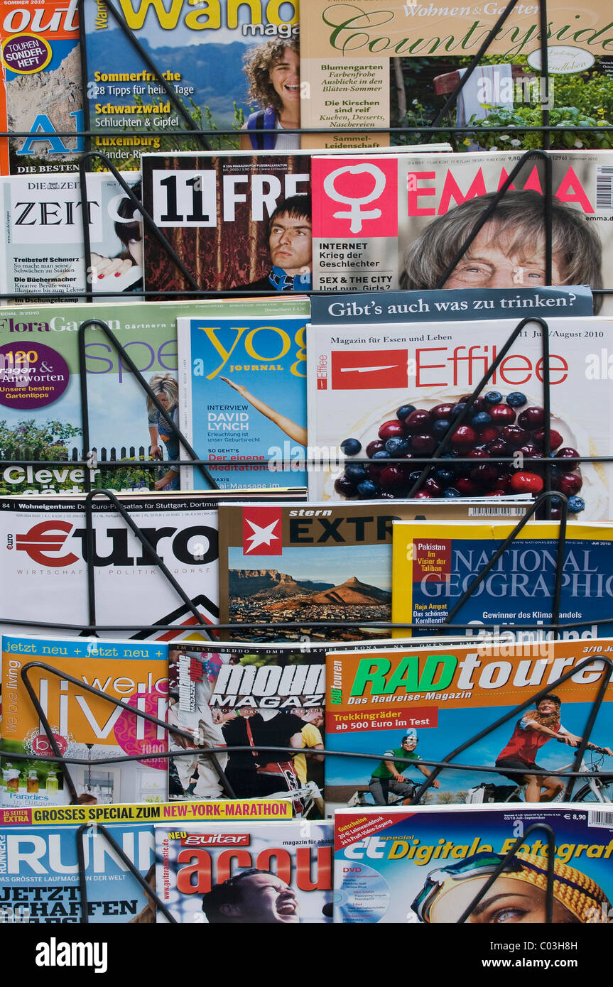 German magazines for sale on a magazine rack - Stock Image