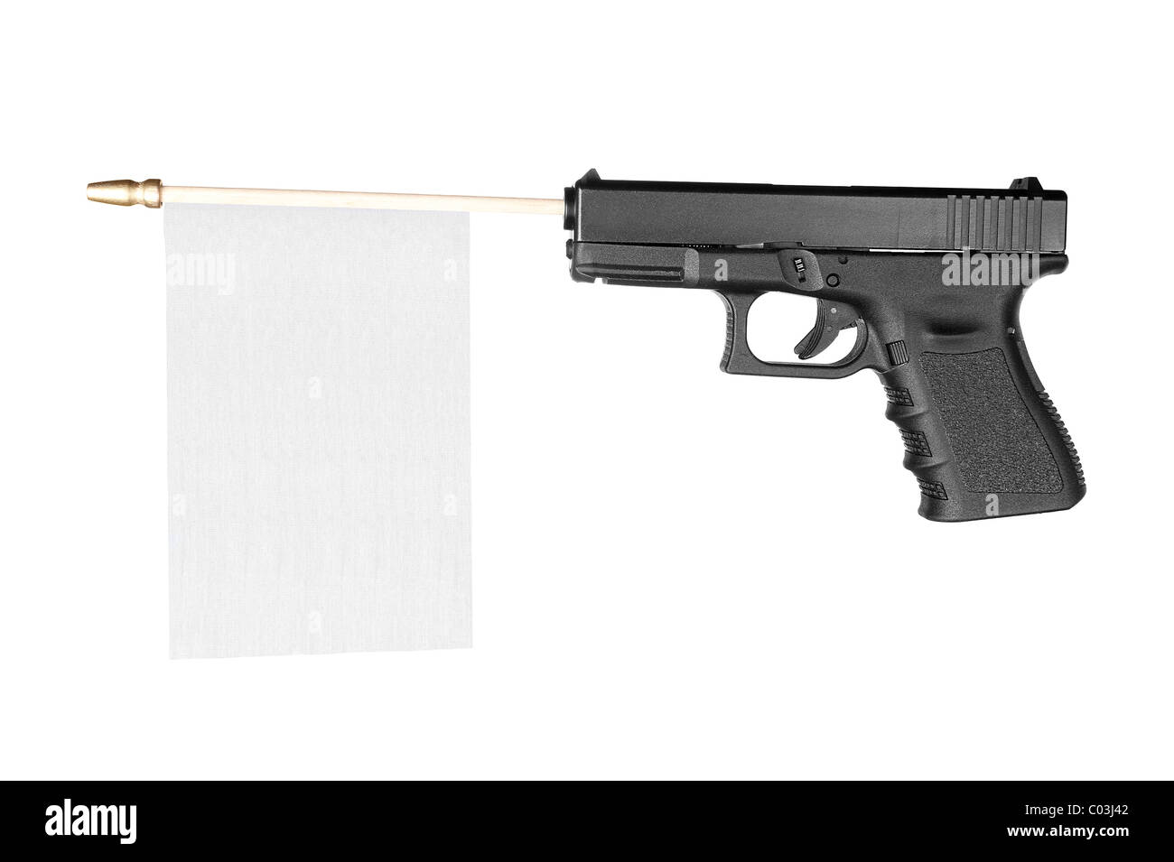 A handgun with a white flag sticking out for use to place copy. - Stock Image