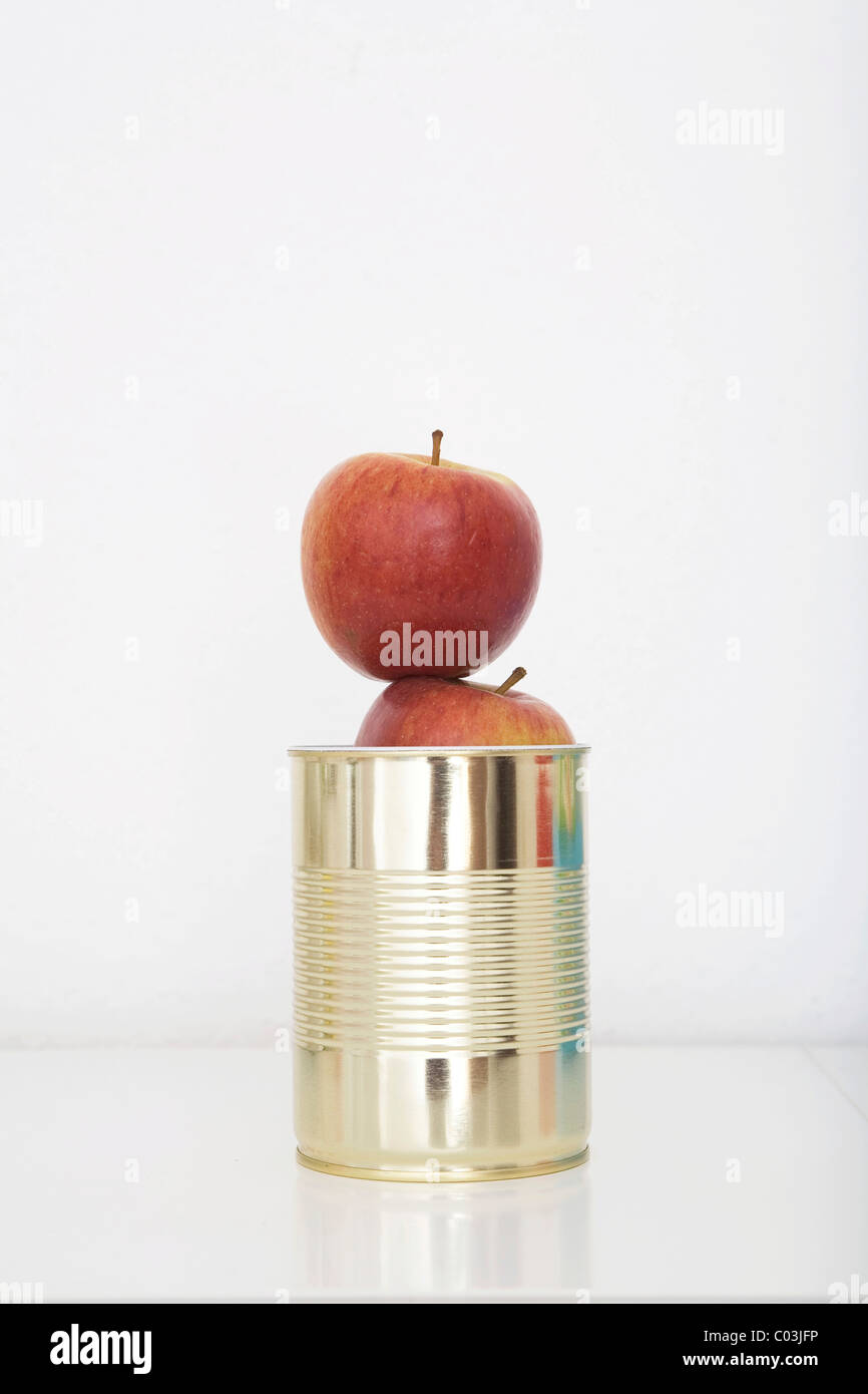 Fresh apples in a tin can, preserved food - Stock Image