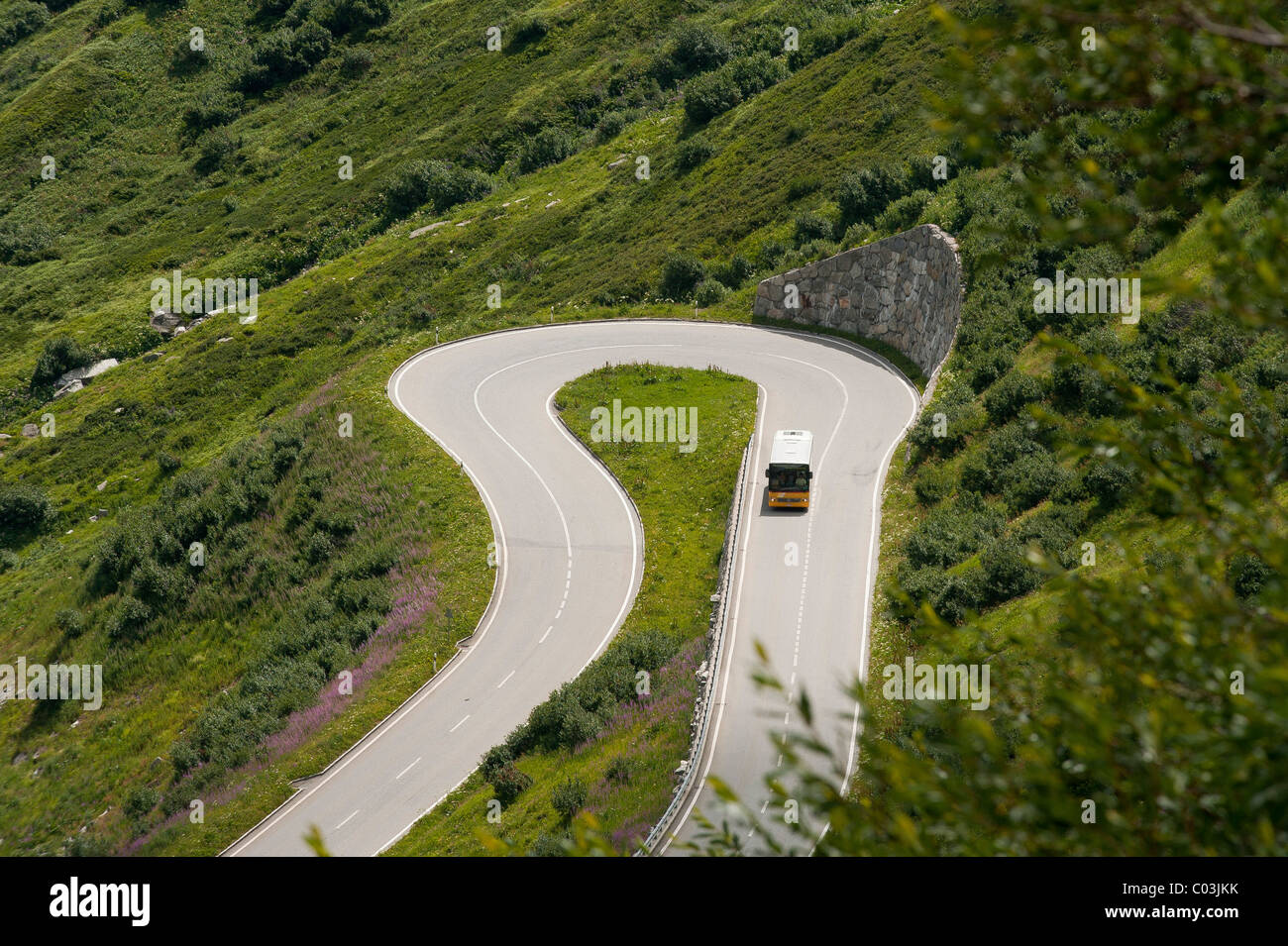 Furka Pass road and a mail bus, canton of Valais, Switzerland, Europe - Stock Image