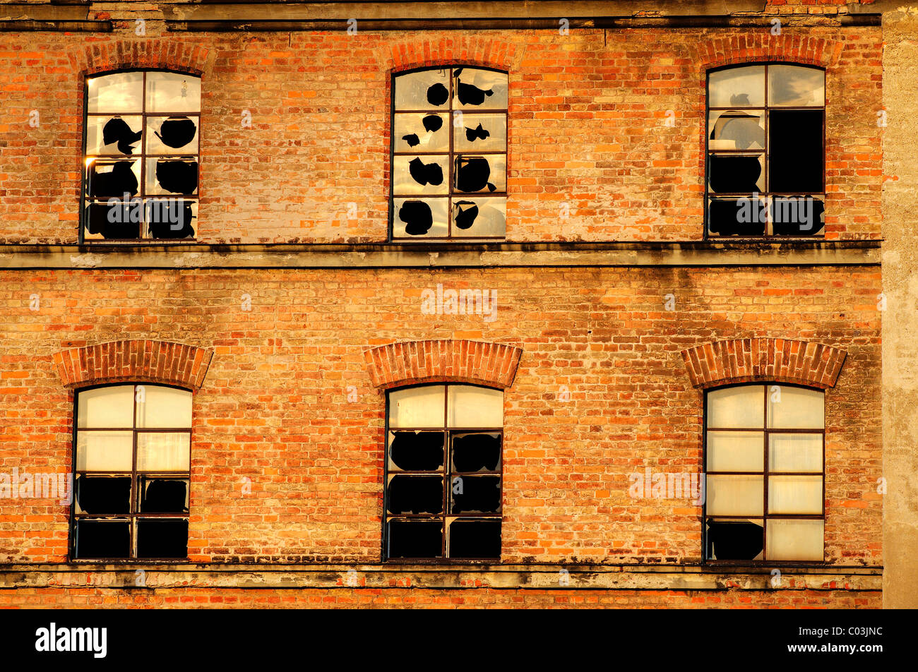 Broken windows on the old factory facade, Kempten, Bavaria, Germany, Europe - Stock Image