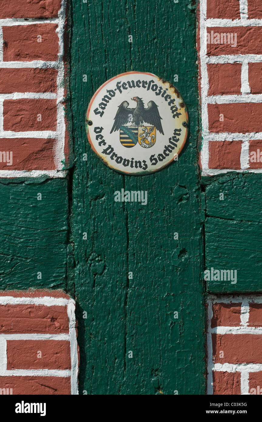 Country Fire Society for the Province of Saxony, insurance sticker on a restored half-timbered facade, northern - Stock Image