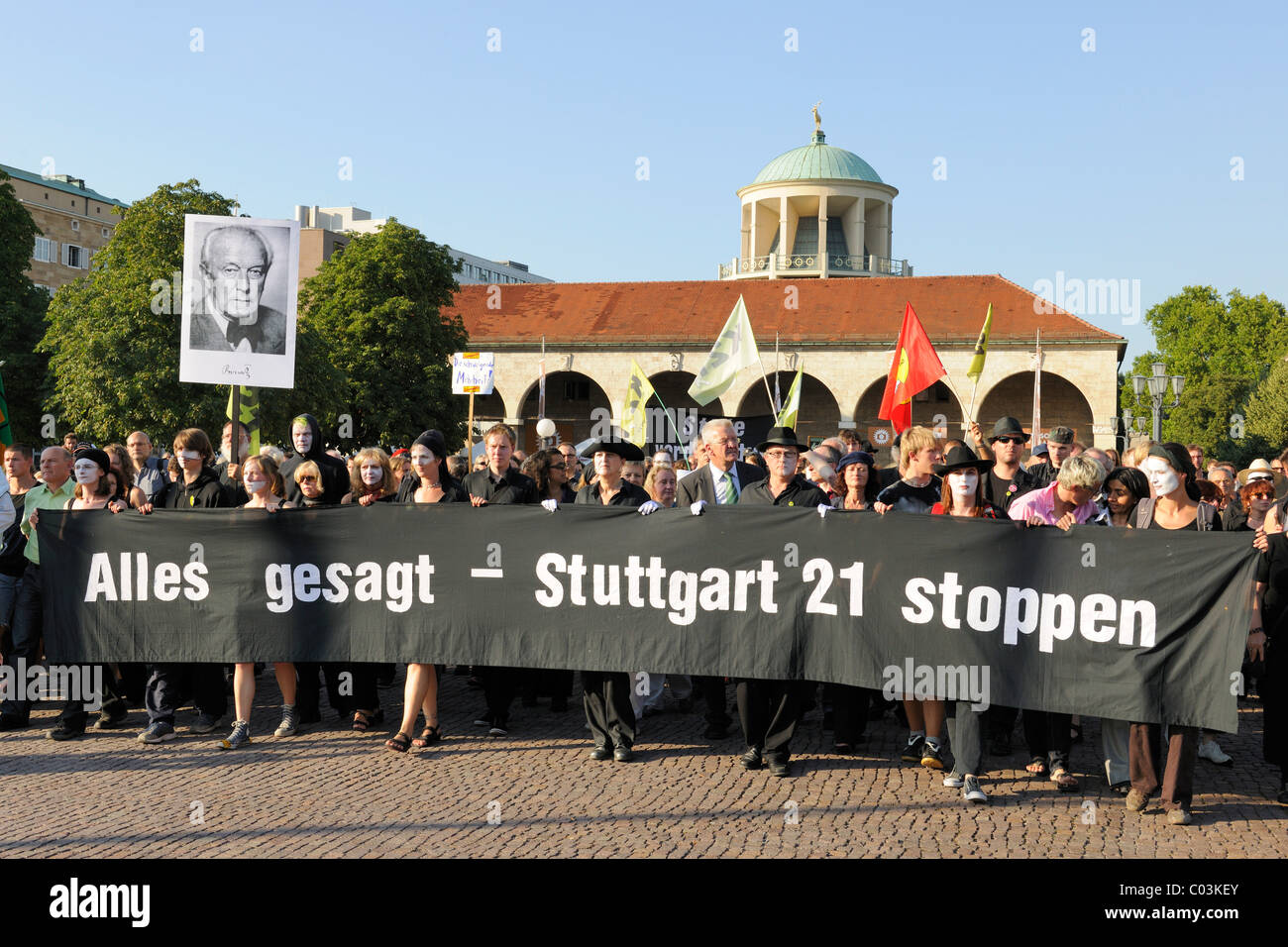 Silent protest march of Stuttgart 21 opponents on the Schlossplatz square against the rebuilding of the railway - Stock Image