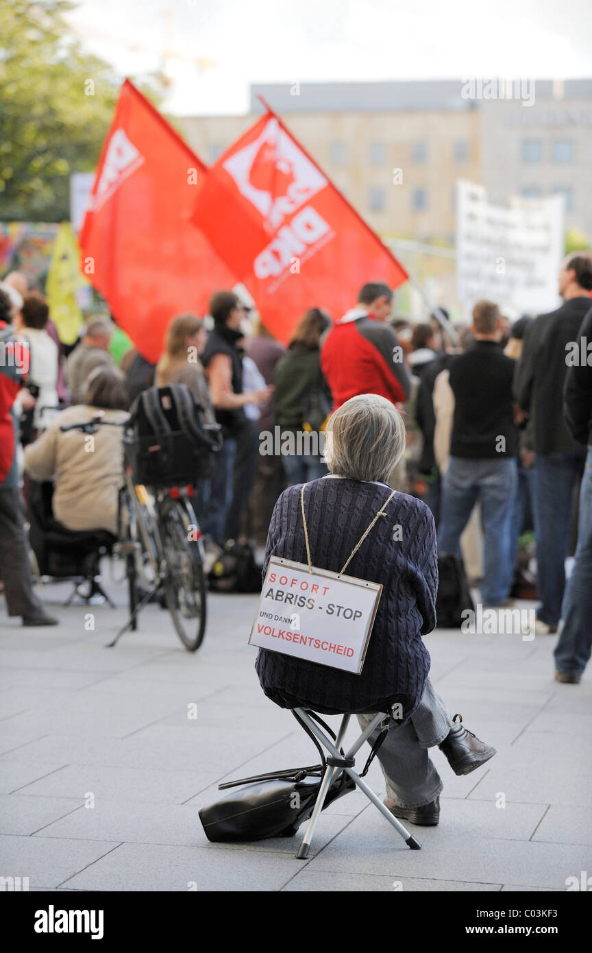 Protester wearing a placard bearing the message, Immediately stop demolition and then hold a referendum, demonstration - Stock Image