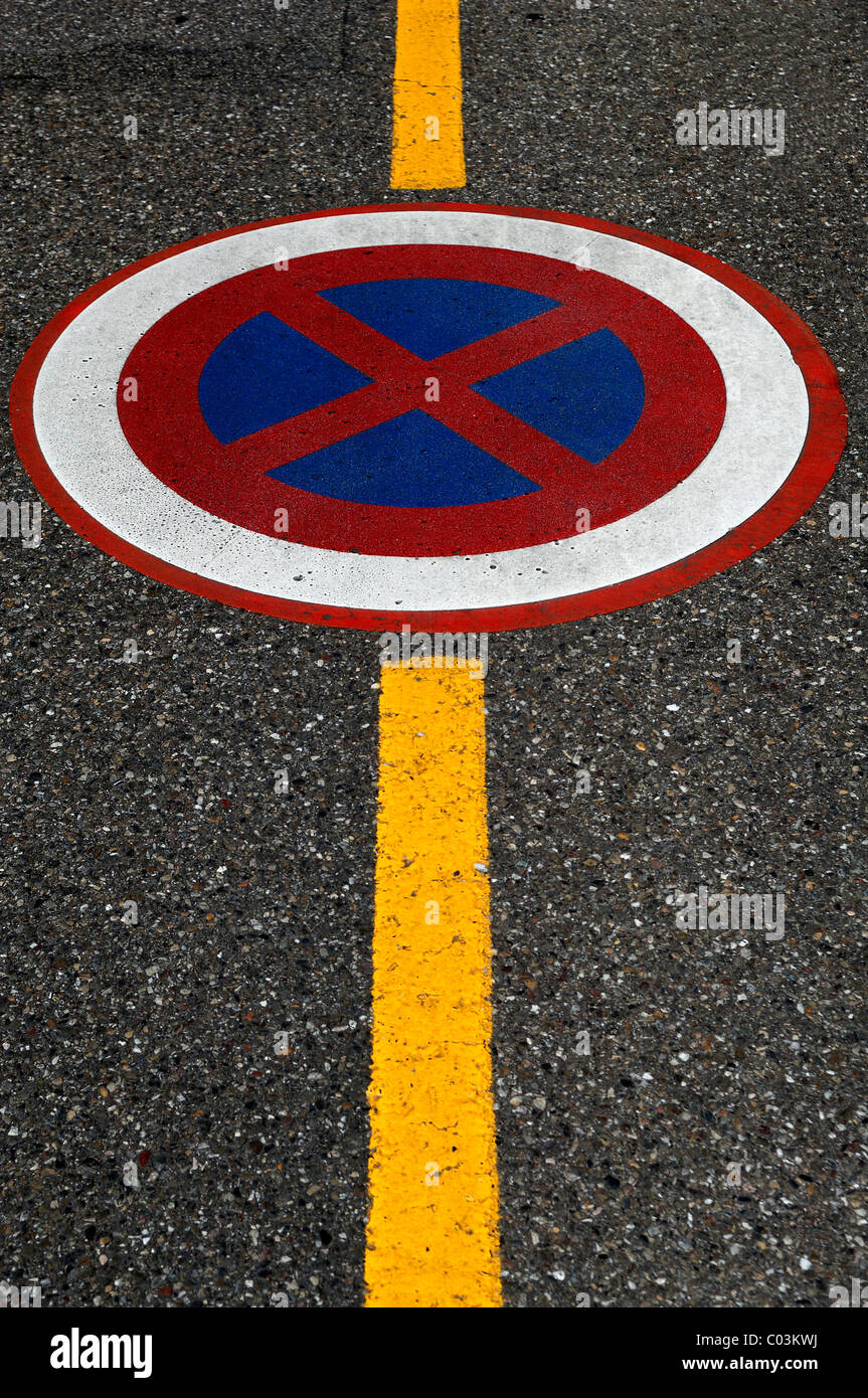 No parking sign with a yellow border line on a road, Ingersheim, Alsace, France, Europe - Stock Image