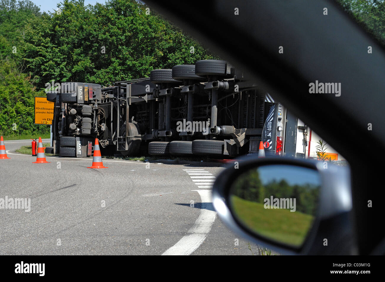 Overturned truck in a roundabout, looking out of a car, Marckolsheim, Alsace, France, Europe - Stock Image