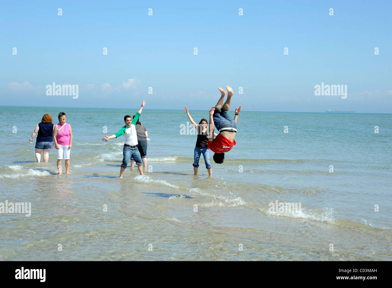 Young person somersaulting in the sea, Skagen, Jutland, Denmark, Europe Stock Photo