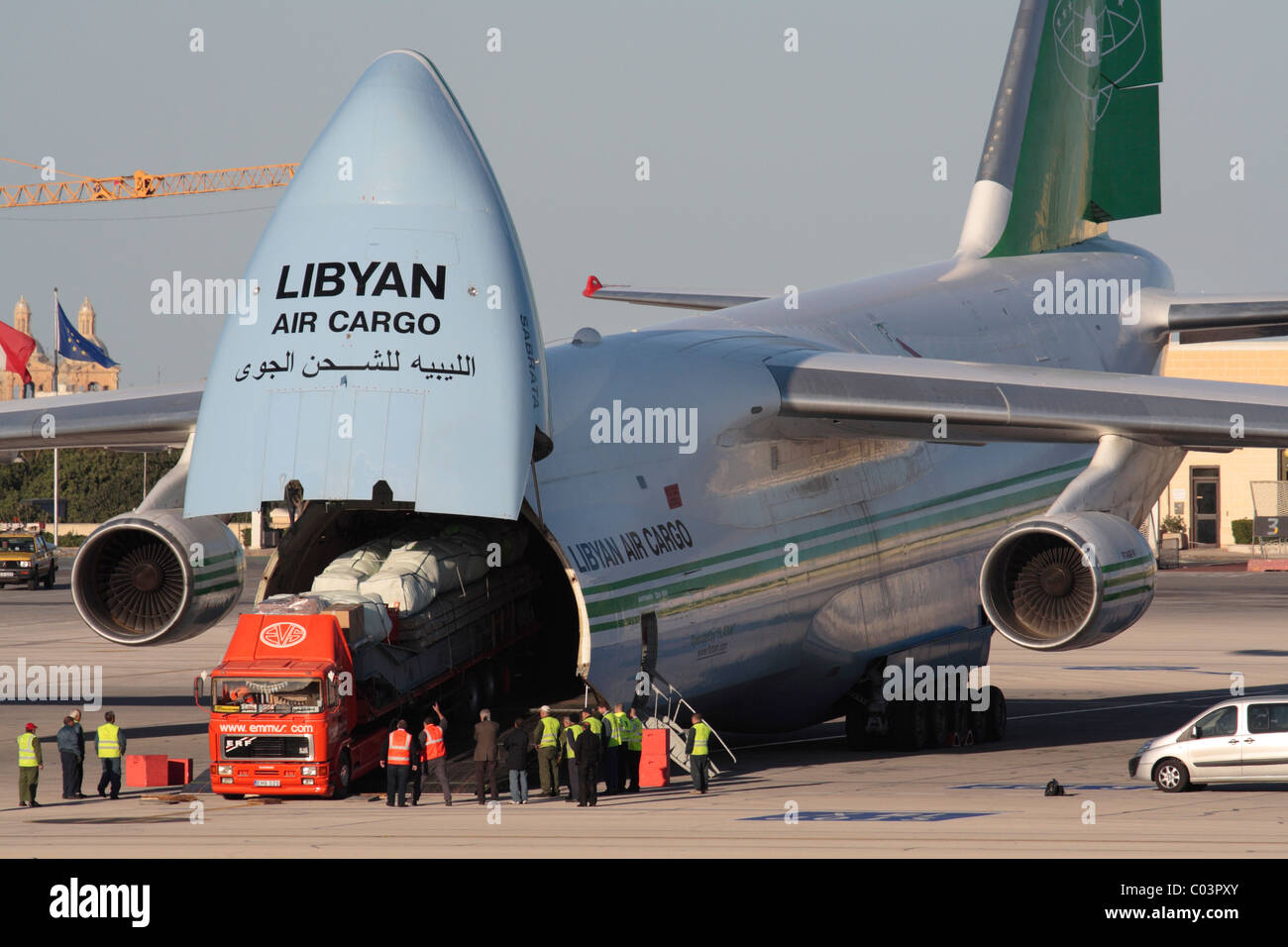 Loading cargo on board a Libyan Air Cargo Antonov An-124 by reversing a trailer truck into the aircraft - Stock Image