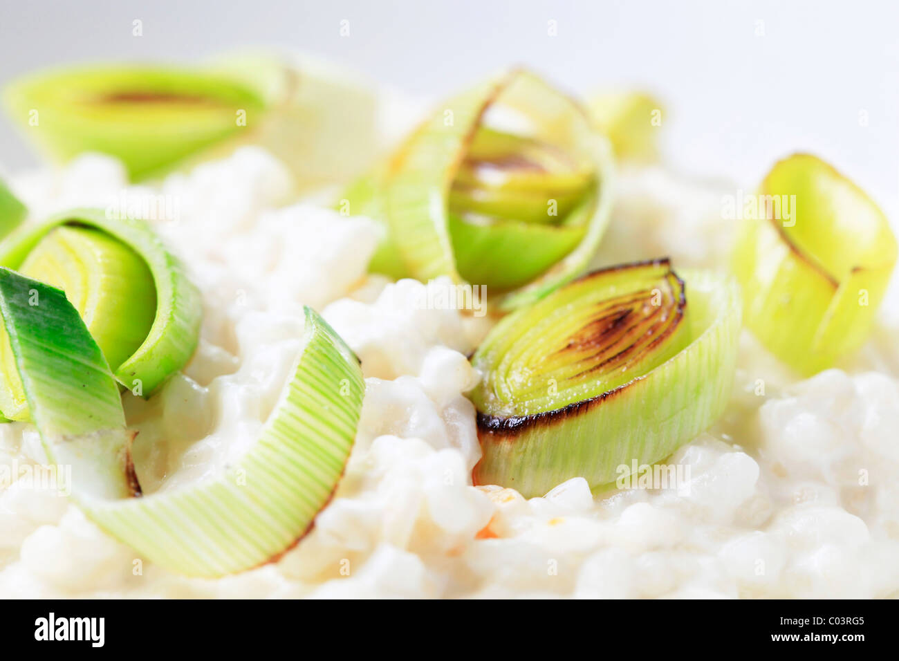 Bowl of rice pudding garnished with leek - Stock Image