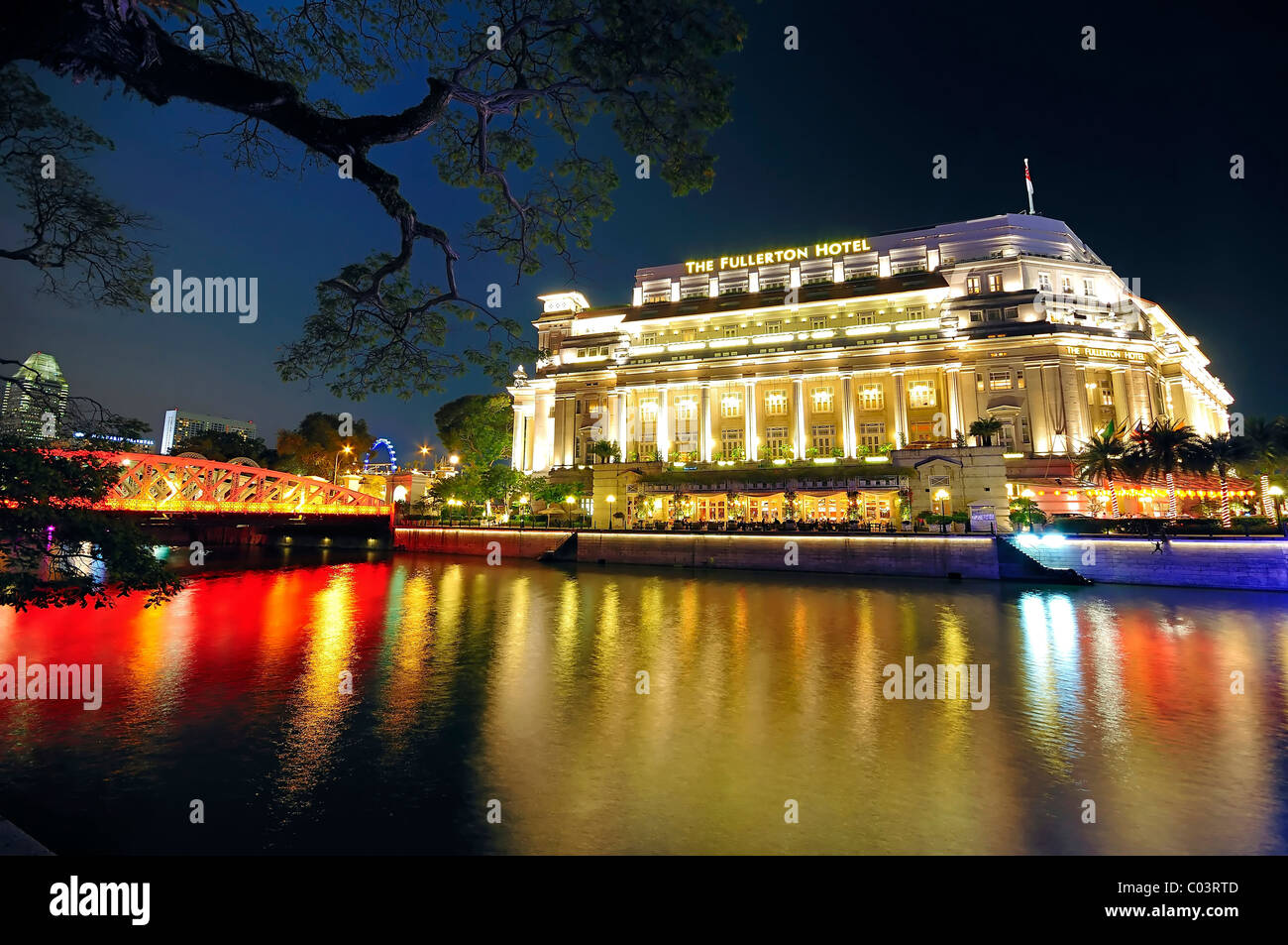 The Fullerton Hotel decked in festive lights during the Chinese New Year celebration in Singapore. - Stock Image