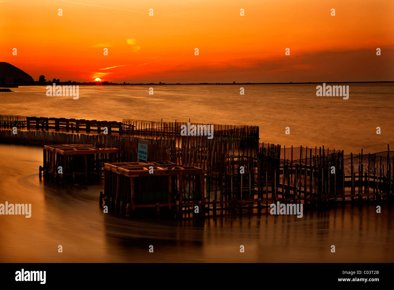 """A """"divari"""" (traditional fish farm) at the end of the bridge that connects Lefkada  island with the mainland of Greece. Stock Photo"""