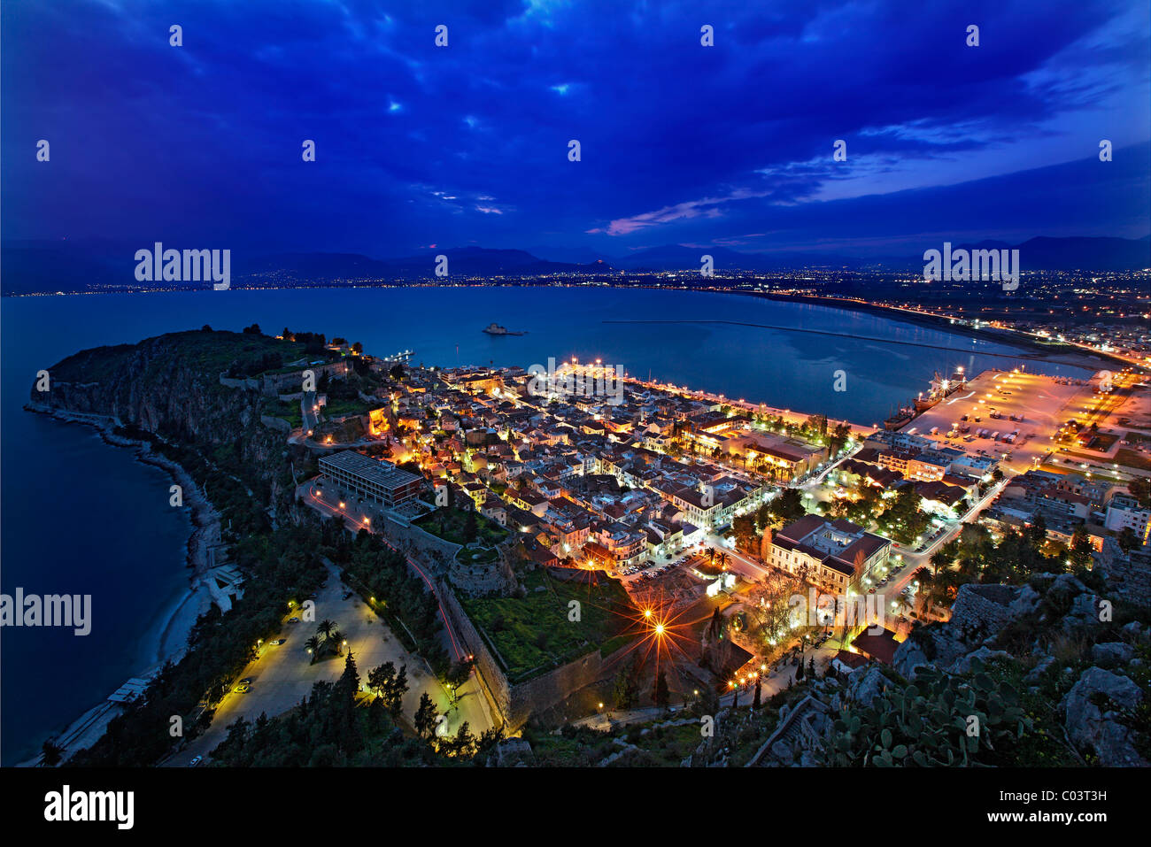 "Panoramic view of Nafplio town and the Argolic gulf from Palamidi Castle, in the ""blue"" hour. Peloponnese, Greece Stock Photo"