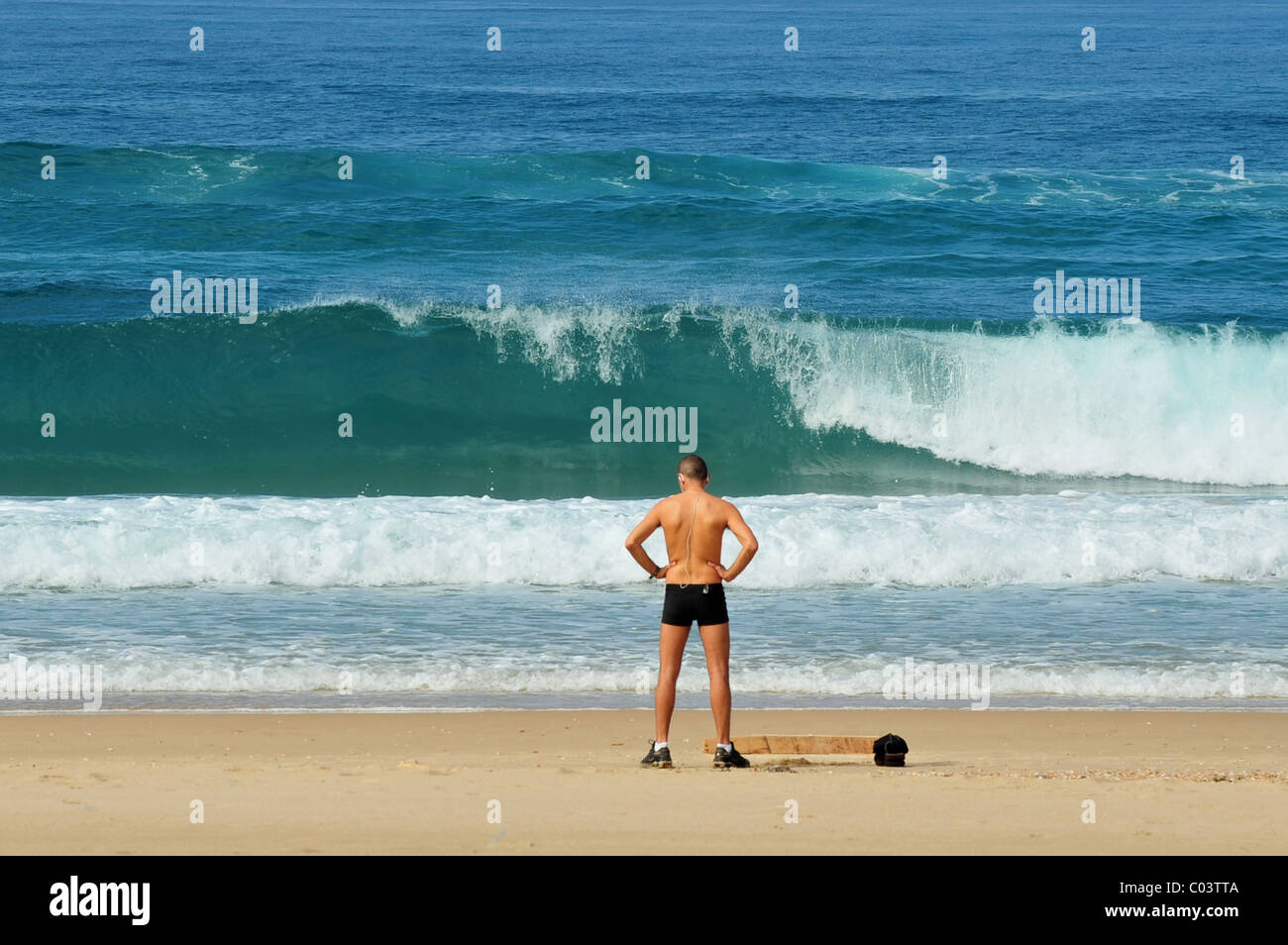 Athlete man exercise on the beach. Stock Photo