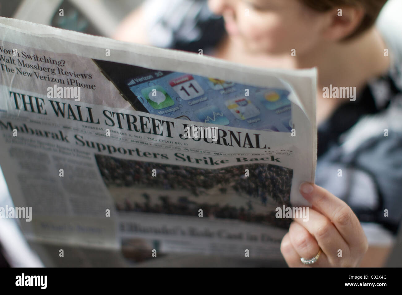 female reading the wall street journal - Stock Image