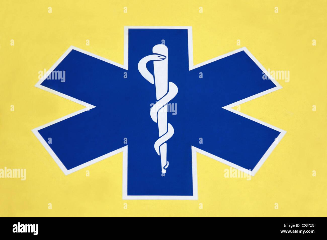 Caduceus, Snake and Staff symbol on front of ambulance, London, UK - Stock Image