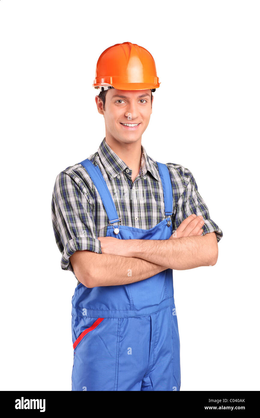 Manual worker wearing blue overall and helmet - Stock Image