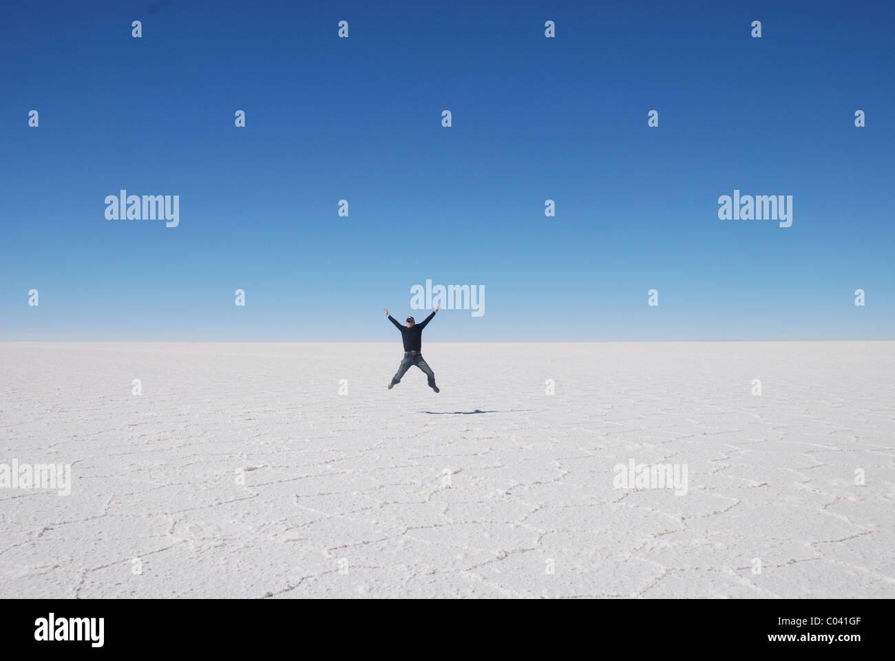 A Star-jump in Salar de Uyuni - the salt flats of Uyuni, Bolivia - Stock Image