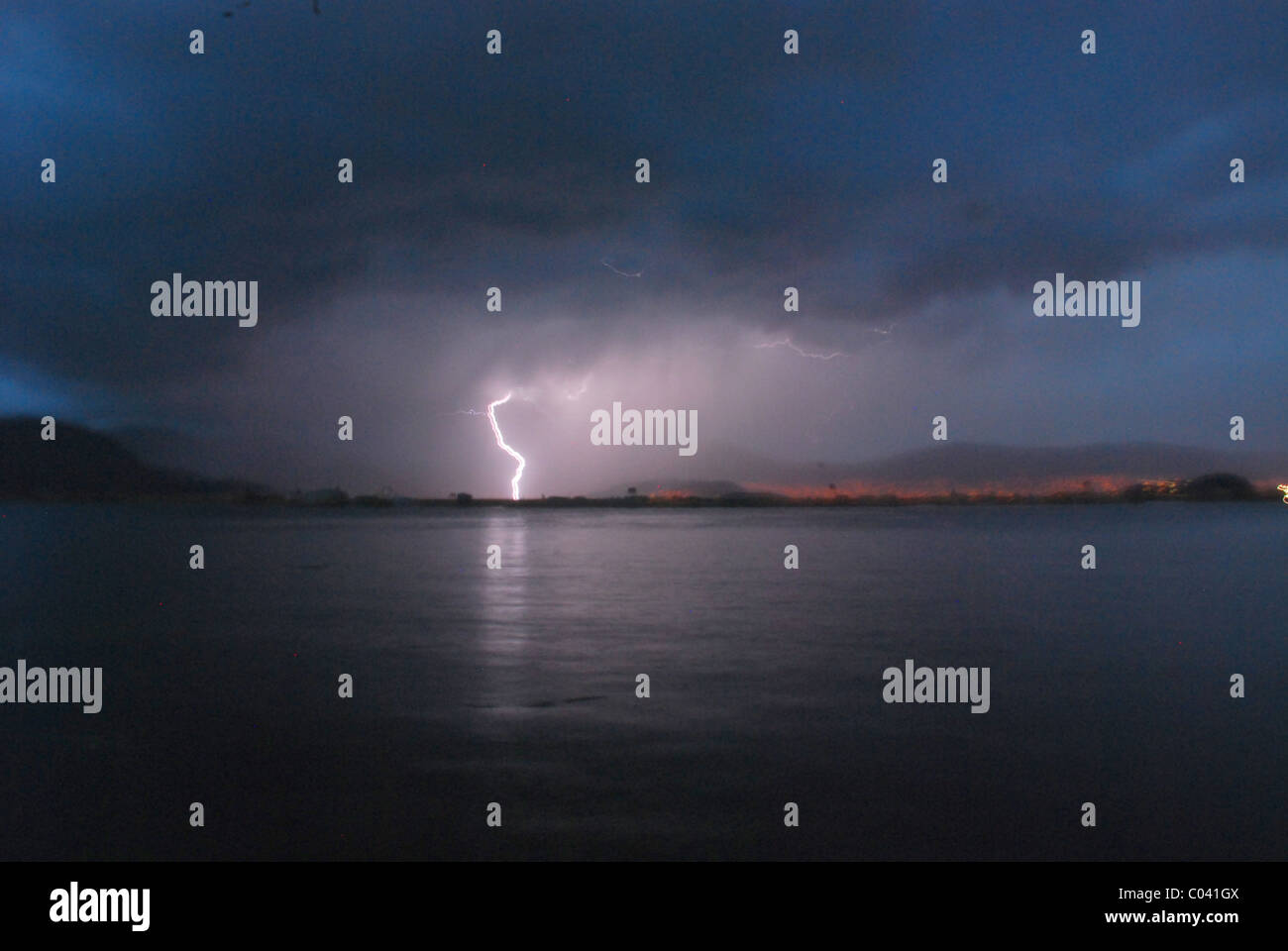 A lightning storm over Lake Titicaca, between Peru and Bolivia - Stock Image