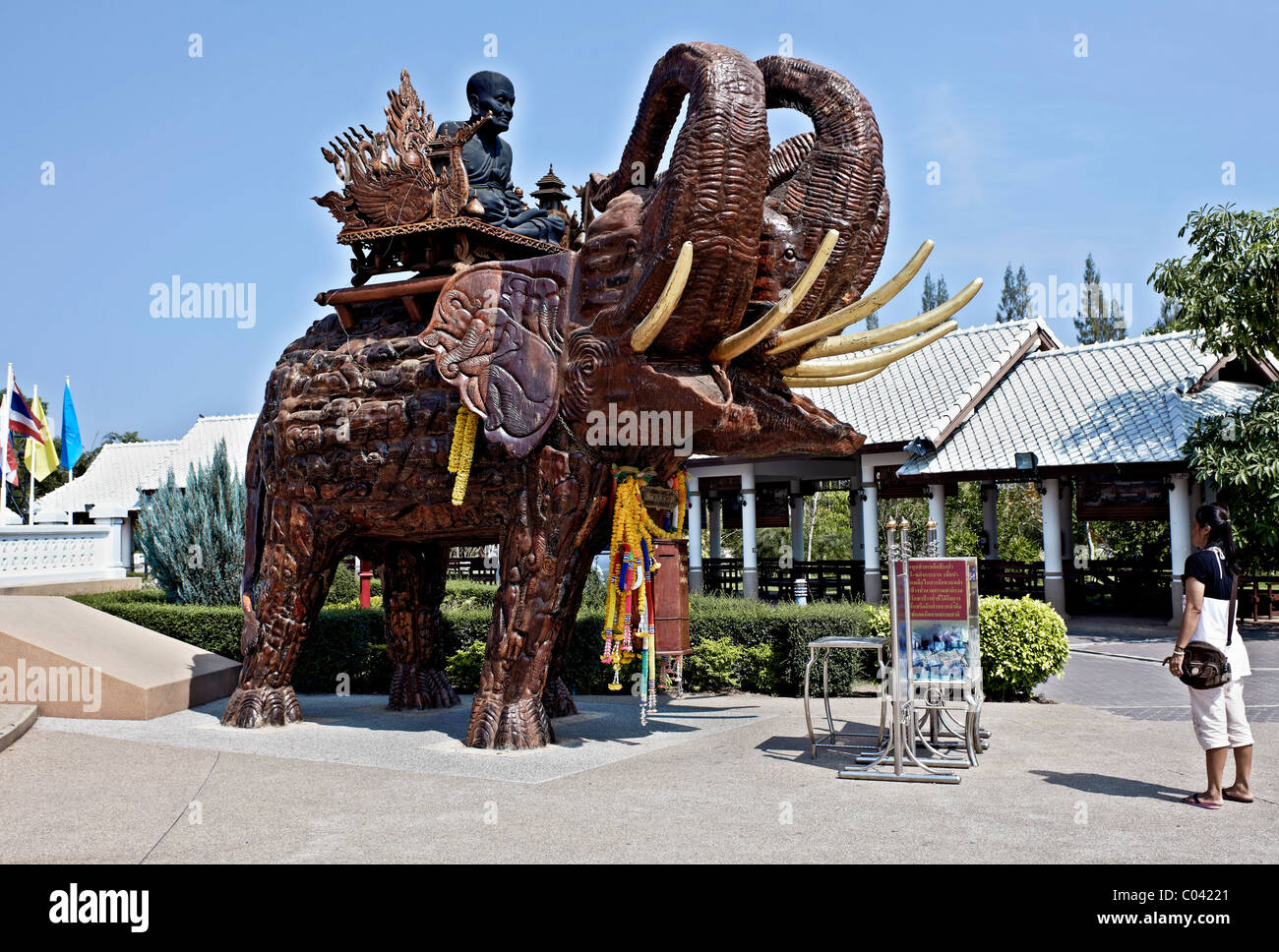 Statue of Thai revered monk Luang Pu Thuat Tuad astride a large wooden elephant Wat Huay Mongkol Hua Hin Thailand - Stock Image