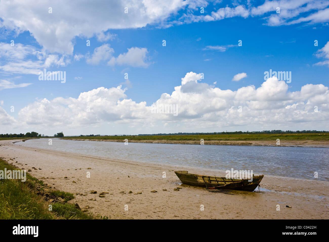 Old wrecked fishing boat in Les Marais de la Douve, the Marais marshland area of Normandy, France - Stock Image