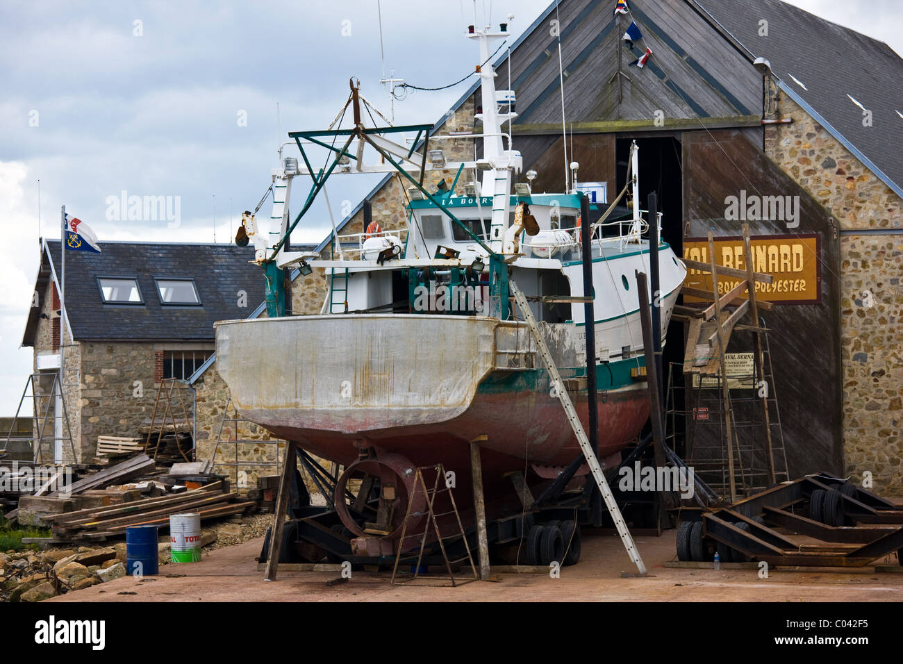 Boatyard at Channel port of St Vaast La Hougue in Normandy, France - Stock Image