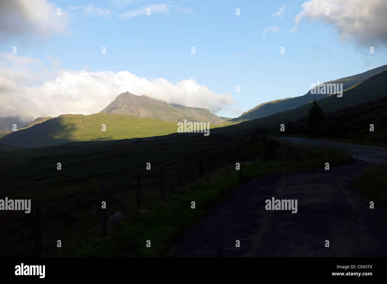 View of Snowdon Massif, Yr Wyddfa from A4086 near Capel Curig Stock Photo