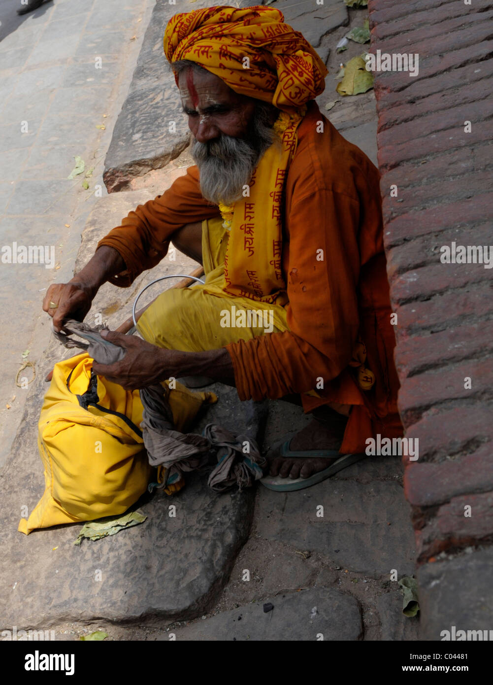 sadhu waiting to pounce on tourists , peoples lives ( the nepalis ) , life in kathmandu , kathmandu street life - Stock Image