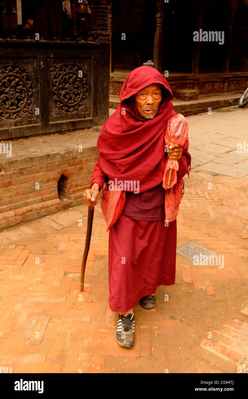 old hermit living among old buildings , peoples lives ( the nepalis ) ,  life in kathmandu , kathmandu street life Stock Photo