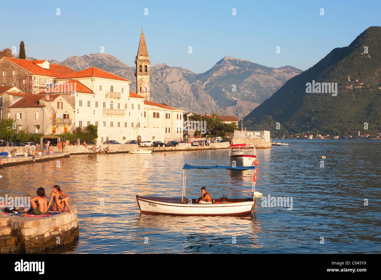 Sunbathers and man in boat, Perast, Boka Kotorska, Montenegro - Stock Image