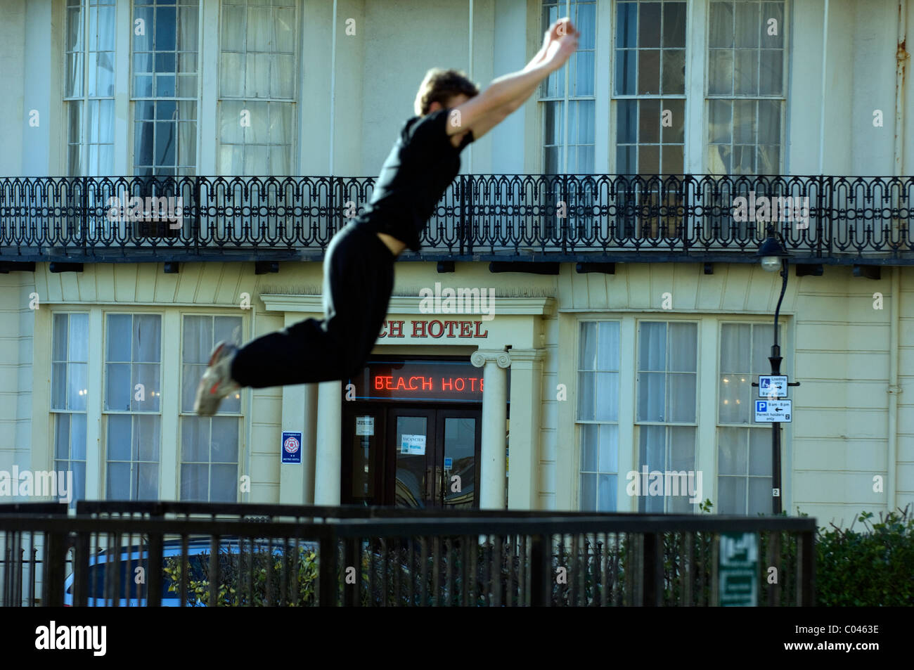 Ben Ockwell practices Parkour, or  FreeRunning, in Regency Square, Brighton, East Sussex, England Britain UK - Stock Image