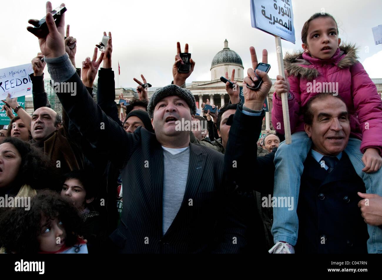 Egyptian Victory celebration on Mubarak's resignation organized by Amnesty International Trafalgar Square London - Stock Image